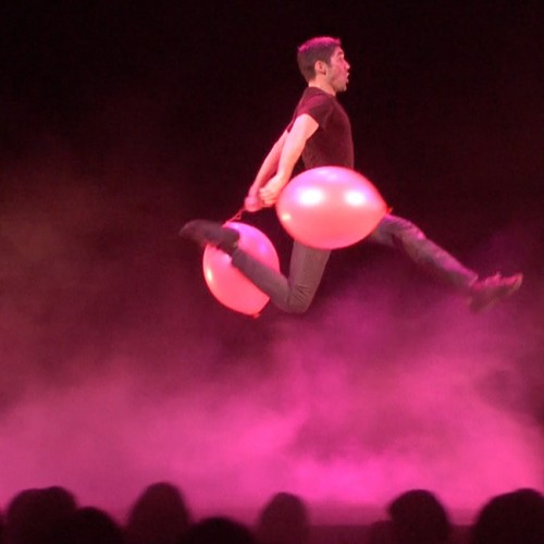 Corporate Comedy Juggler Josh Casey leaping through the air